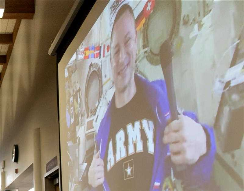 PMG PHOTO: JAIME VALDEZ - After pointing out he was a soldier through and through, Col. Andrew Morgan jokingly opened his NASA flight suit to reveal a black U.S. Army T-shirt.