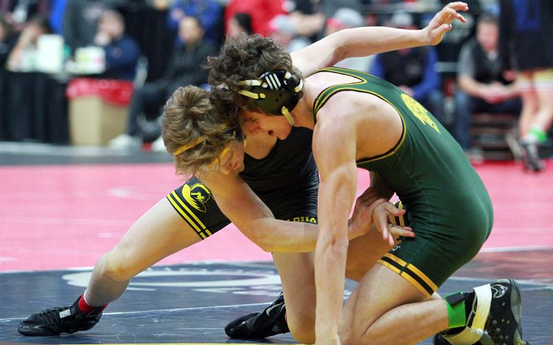 PMG MEDIA PHOTO: MILES VANCE - Aloha senior star Colton Fleming finished sixth at the Class 6A state tournament at 152 pounds.
