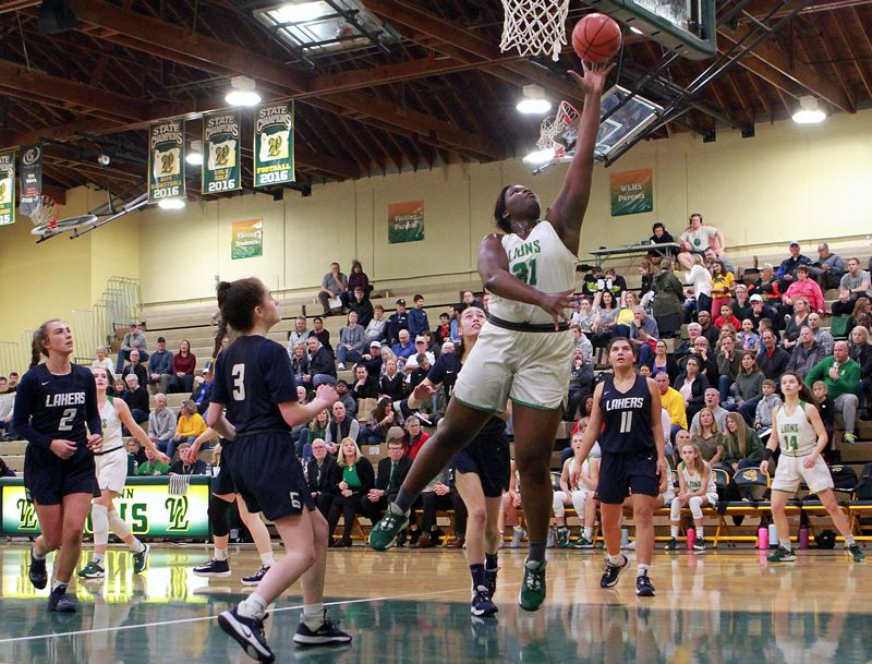 PMG PHOTO: MILES VANCE - West Linn junior post Aaronette Vonleh goes up to score during her team's 75-24 win over Lake Oswego at West Linn High School on Friday, Feb. 28.