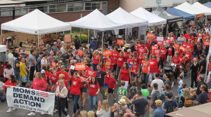 PMG PHOTO: BILL GALLAGHER - Moms Demand Action march in the Multnomah Days parade in August 2019, in support of legislation to curb gun violence.