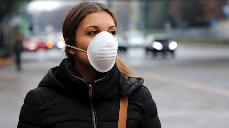 COURTESY PHOTO: DREAMSTIME - A woman wears a face mask in public. Public health officials say that face masks can reduce the risk of a wearer who is infected passing the virus on to others, although their effectiveness is very limited when worn by people who haven't contracted the virus.