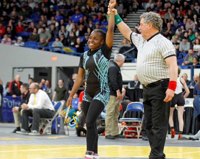 PMG PHOTO: WADE EVANSON - Century's Nimo Sheikh celebrates her victory in the girls 105 pound weight division during last weekend's OSAA/OnPoint State Wrestling Championships at the Memorial Coliseum.