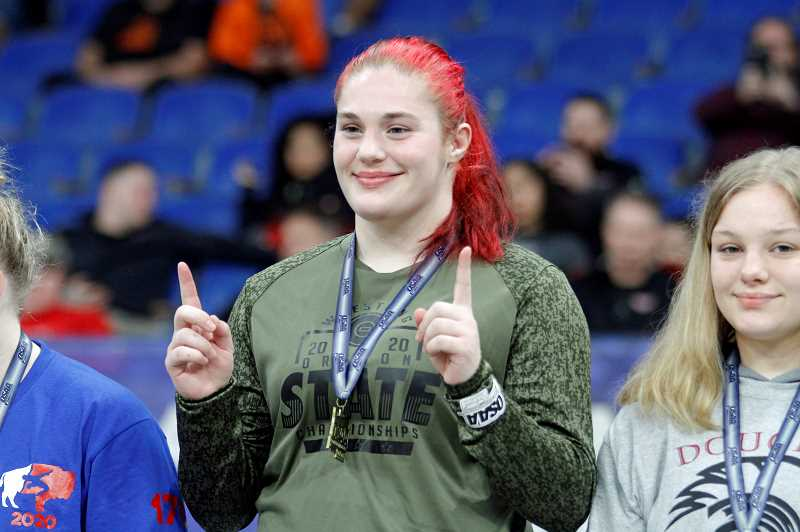 PMG PHOTO: WADE EVANSON - Glencoe's Olivia Robinson accepts her first place medal during the OSAA/OnPoint State Wrestling Championships.