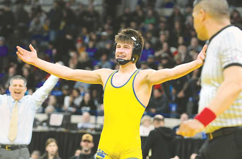 GRAPHIC PHOTO: GARY ALLEN - Charlie Evans celebrates after securing the 132-pound title.