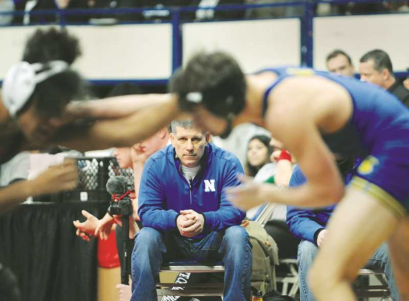 GRAPHIC PHOTO: GARY ALLEN - Coach N eil Russo concentrates on a match during prelims Saturday morning at Memorial Coliseum.