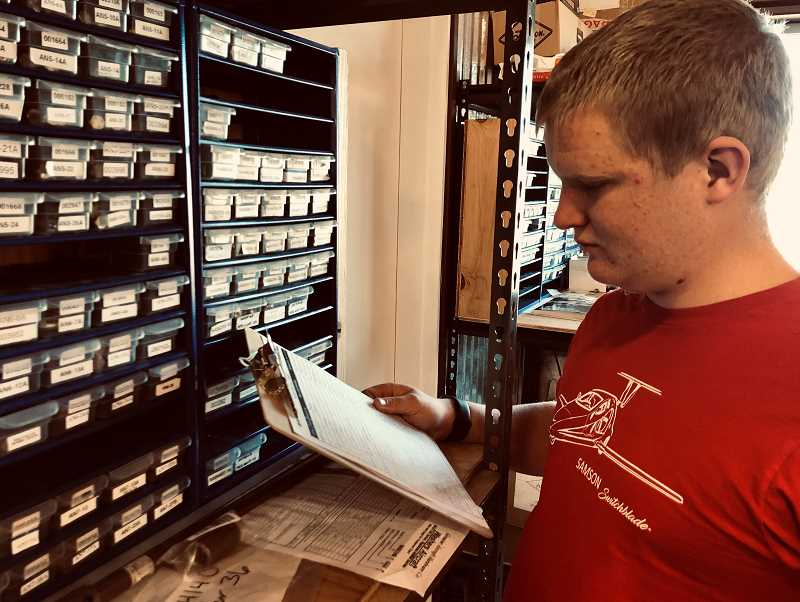 PHOTO SUBMITTED BY MARTHA BOUSFIELD  - Ronald Forseth is doing some inventory for Samson Sky, helping keep things accounted for and in their proper place.