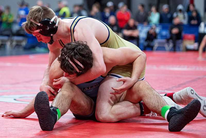 LON AUSTIN/CENTRAL OREGONIAN - Gavin McLean dominated the Class 5A third-place match at 160 pounds, taking a 12-0 major decision over Izaak Worsch of Corvallis.