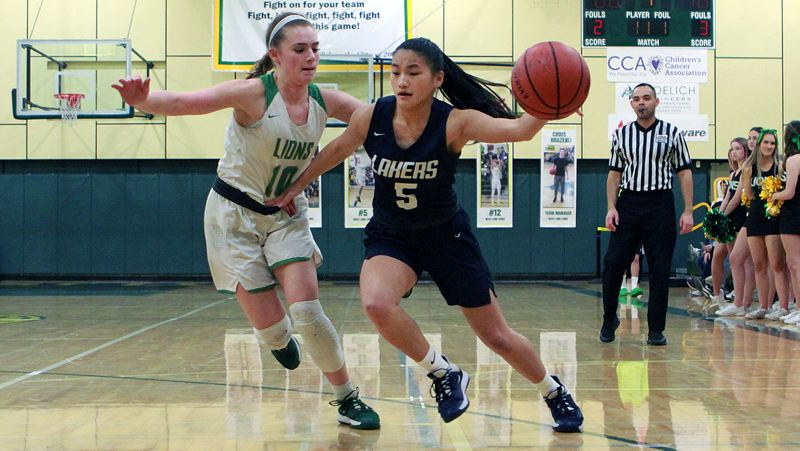 PMG PHOTO: MILES VANCE - Lake Oswego sophomore Maria Fernandez tries to control a loose ball during her team's 75-24 loss to West Linn at West Linn High School on Friday, Feb. 28.