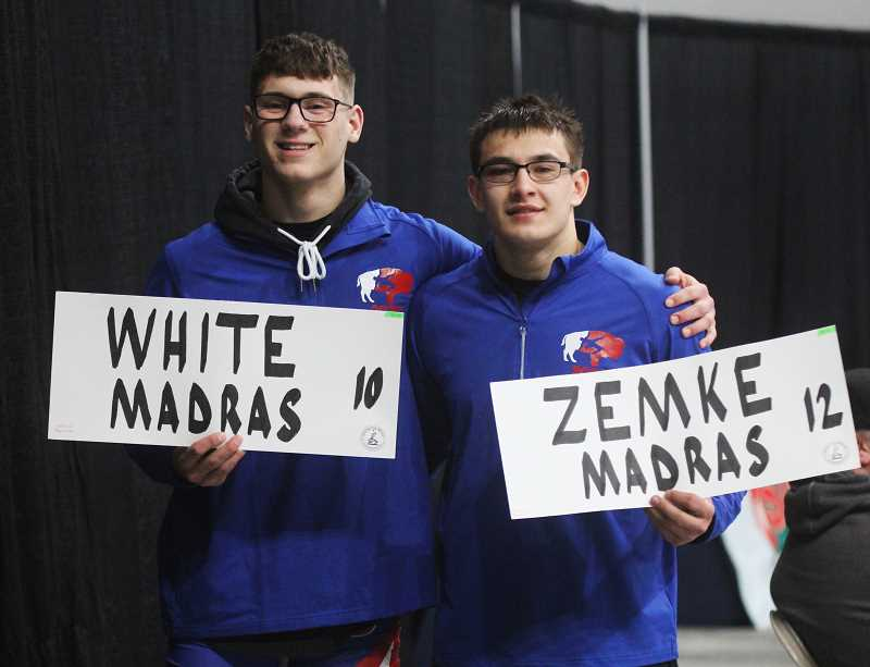 STEELE HAUGEN - Reece White and Kody Zemke hold up their name cards at the state wrestling tournament in Portland Feb. 27-28. White placed third and Zemke fifth at the 4A level.