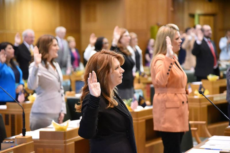 PMG FILE PHOTO - Members of the Oregon House of Representatives, including Republican leader Christine Drazan, foreground, swear to serve during Day 1 of this year's legislative session.