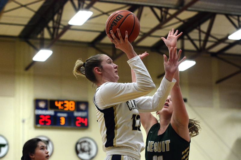 PMG PHOTO: DEREK WILEY - Canby senior Nicole Mickelson scored a game-high 14 points Tuesday against Jesuit.