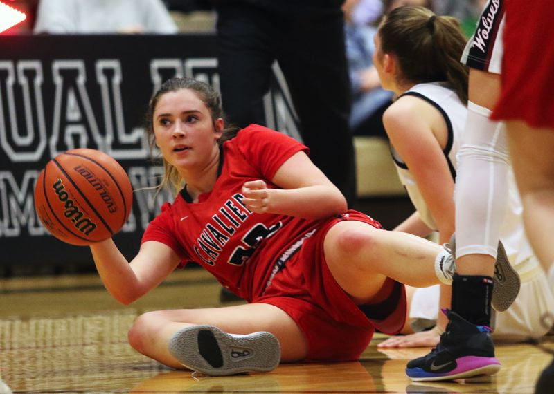PMG PHOTO: DAN BROOD - Clackamas High School junior Maddie Tacheny gets to a loose ball during Tuesday's Class 6A state playoff first-round game at Tualatin. The Wolves won 50-40 in double overtime.