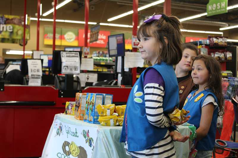 DESIREE BERGSTROM/MADRAS PIONEER - Haddi Murders and her troopmates, Sophia and Ofelia Castrejon, have had a very successful cookie season this year, selling about 650 boxes so far. They have one more weekend to go.