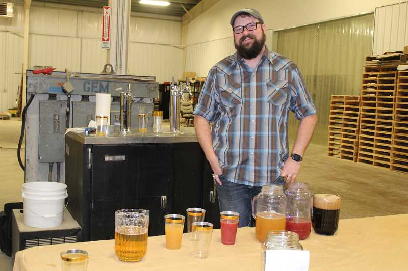 JANE AHERN/FOR THE PIONEER - Seth Klann, whose Mecca Grade Estate hosted the Feb. 27 History Pub, served samples of specialty beers brewed at the location.