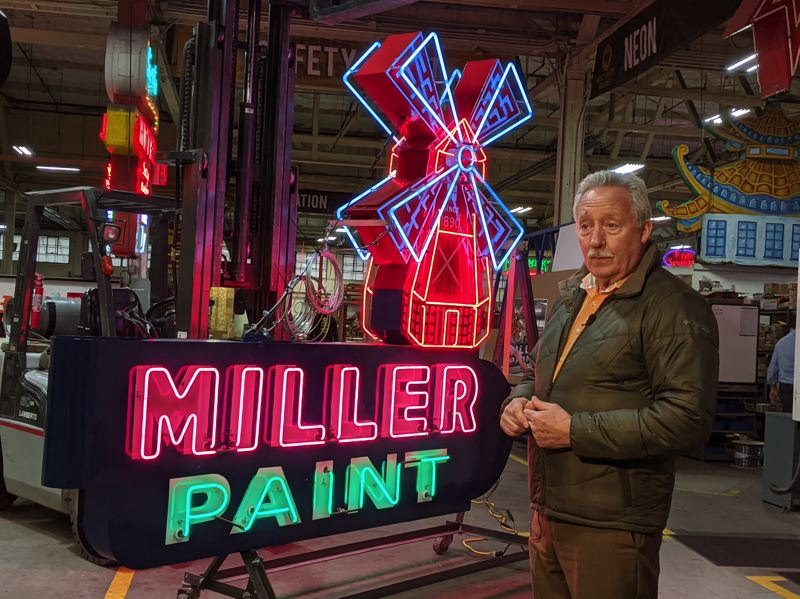 PAMPLIN MEDIA GROUP: JOSEPH GALLIVAN  - Steve Dearborn, CEO and president of Miller Paint Co., stands with the famous windmill neon sign which has been restored and returned to its Grand Avenue perch. Prosper Portland contributed half of the cost of the restoration with a storefront improvement grant.