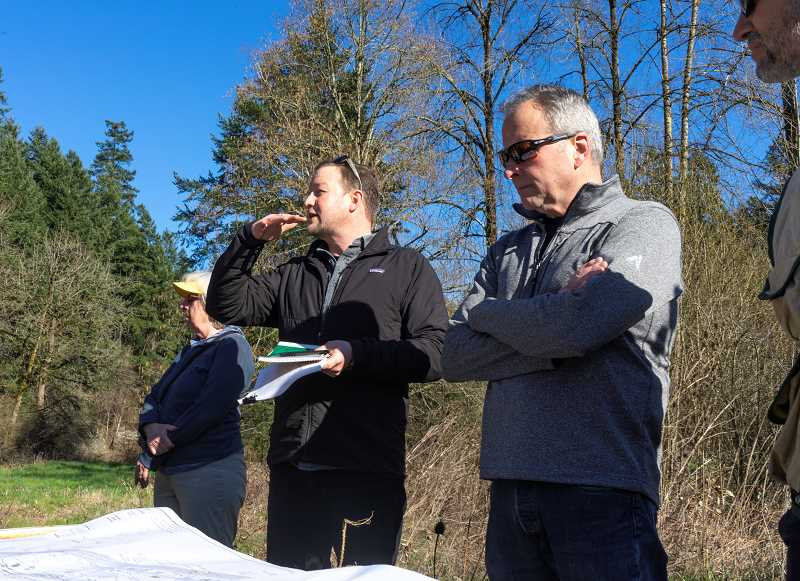 PMG PHOTO: CLARA HOWELL  - Landscape architect Steve Roelof, center, takes the lead on explaining the proposed Iron Mountain Park plans to community members.
