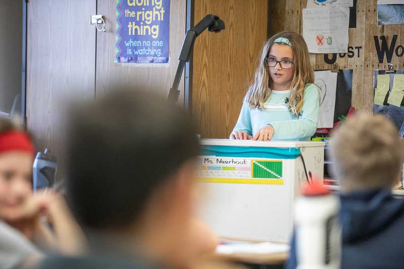 PMG PHOTO: JONATHAN HOUSE - Forest Hills fourth grader Brystol Leslie reads a letter from her grandmother who lived in Europe during WWII as part of her class letters project.