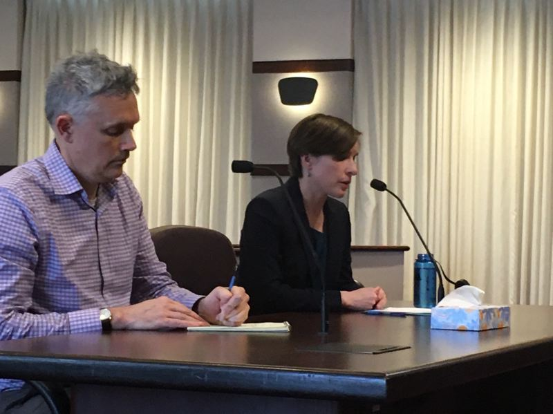 PMG PHOTO BY PETER WONG - Dr. Christina Baumann, right, Washington County's public health officer, speaks to county commissioners about the COVID-19 virus before the board passed an emergency resolution on Wednesday, March 4. At left is John Wheeler, interim county emergency program manager.