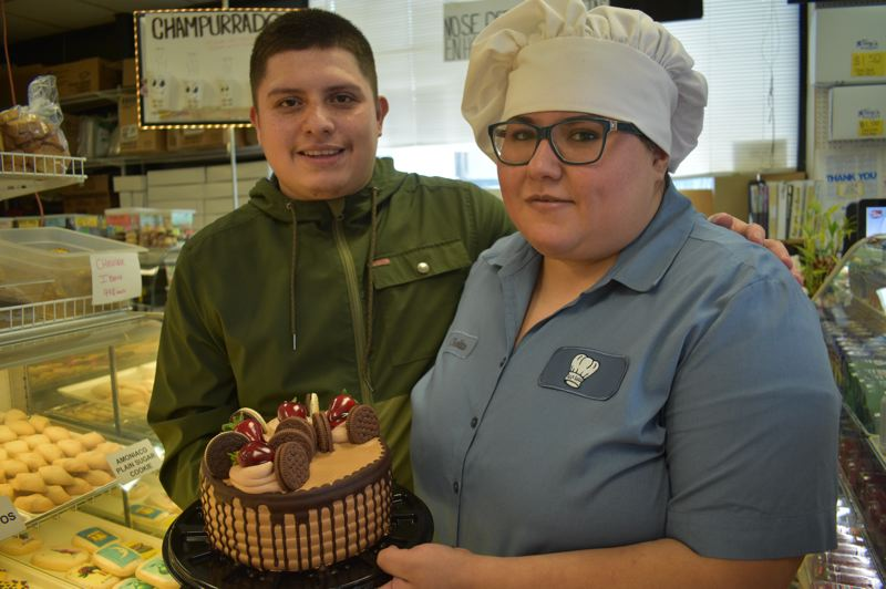 PMG PHOTO: SHANNON O. WELLS - Rudy Loeza and his sister Shelly show off a multi-layered Neapolitan cake, one of the many unique specialties at Tany's Bakery, which the Loeza family has operated in Fairview since 2005.