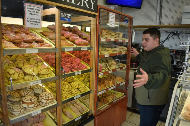 PMG PHOTO: SHANNON O. WELLS - Rudy Loeza shows off the pastry and cookie cases at Tany's Bakery, which his father, Rodolfo Tany Loeza, started in 2005 after baking and selling from home for years.