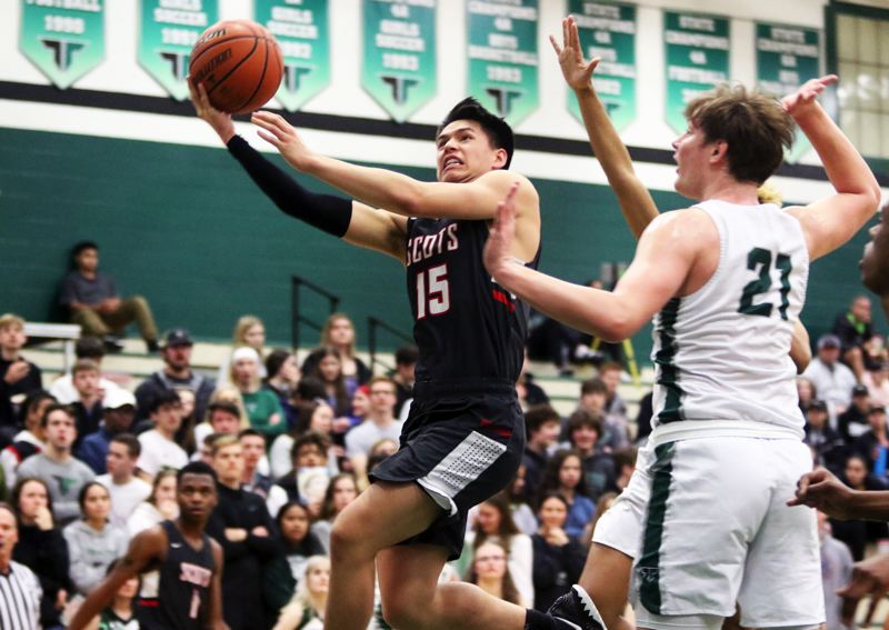 PMG PHOTO: DAN BROOD - David Douglas High School junor Trenton Templeton (15) goes to the basket during the Scots' Class 6A state playoff game at Tigard on March 4.