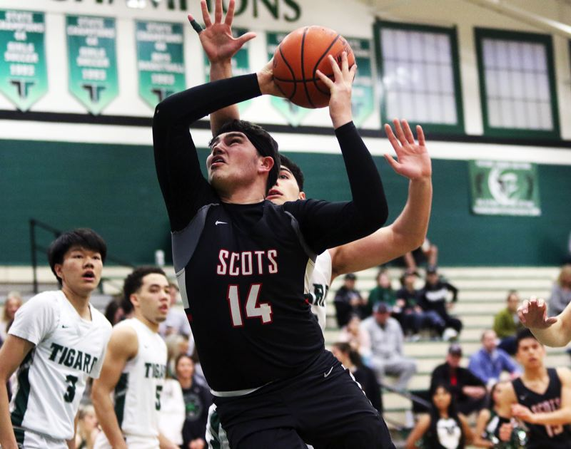 PMG PHOTO: DAN BROOD - David Douglas senoir Dakota Lohmeier tries to power his way to the basket during the Scots' Class 6A state playoff game at Tigard.