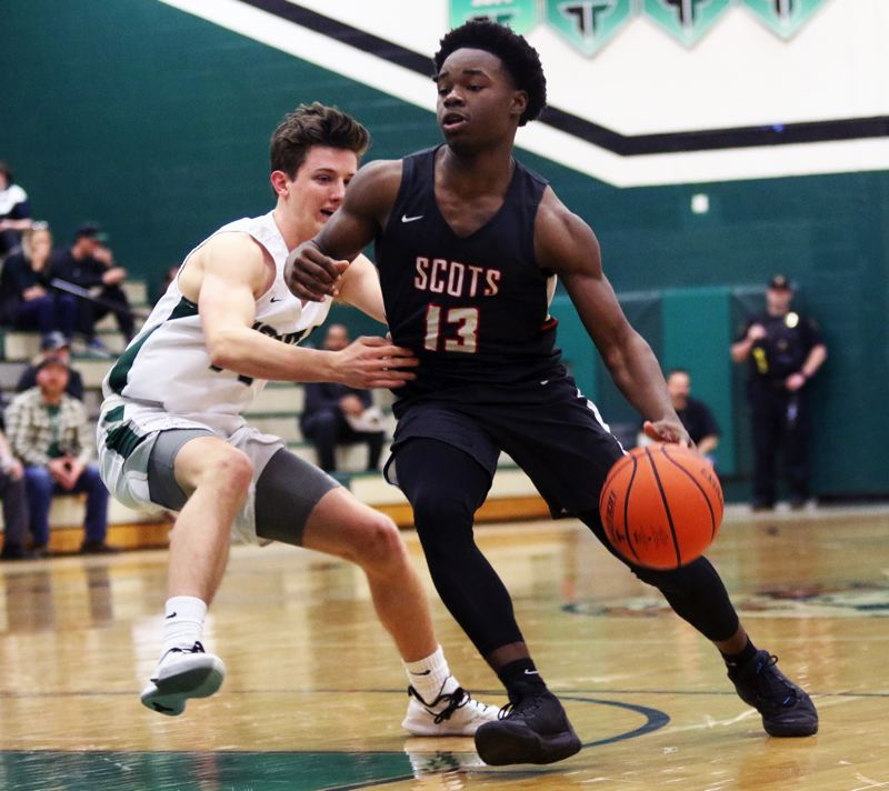 PMG PHOTO: DAN BROOD - David Douglas sophomore guard Josiah Collins looks to move the ball into the paint during the Scots' Class 6A state playoff game at Tigard.