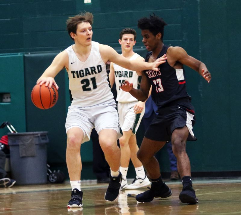 PMG PHOTO: DAN BROOD - Tigard High School senior post Dylan Berg scored 13 points off the bench to provide a spark for the Tigers in their 69-62 state playoff win over David Douglas.