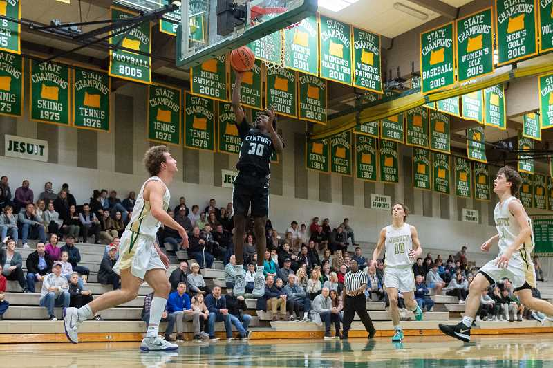 PMG PHOTO: CHRISTOPHER OERTELL - Century's Edidem Essien (30) in the first round of the OSAA 6A boys basketball playoffs at Jesuit High School in Beaverton, Ore., on Wednesday, March 4, 2020.
