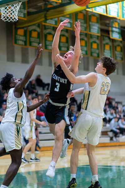 PMG PHOTO: CHRISTOPHER OERTELL - Century's Kyle Hamnes (3) in the first round of the OSAA 6A boys basketball playoffs at Jesuit High School in Beaverton, Ore., on Wednesday, March 4, 2020.