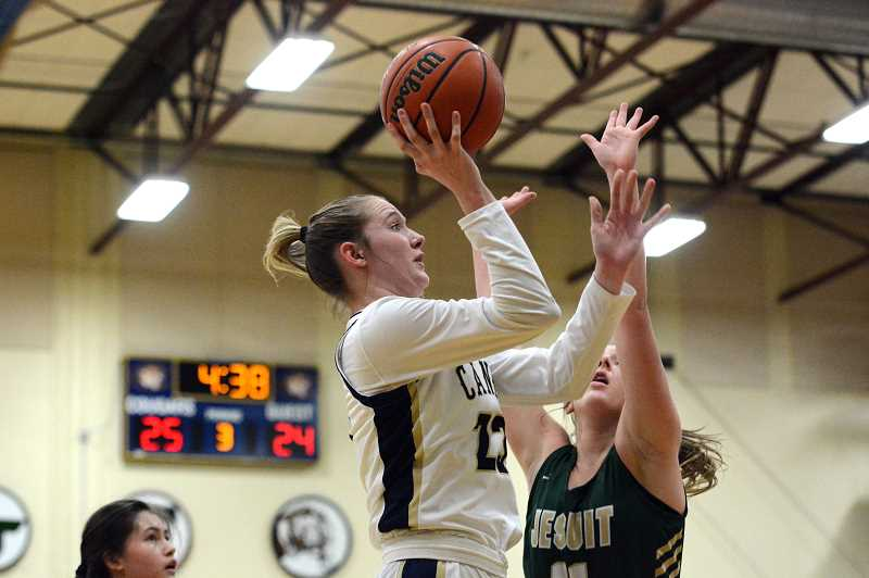 PMG PHOTO: DEREK WILEY - Senior Nicole Mickelson scored 14 points in Canby's first round playoff game against Jesuit Tuesday.