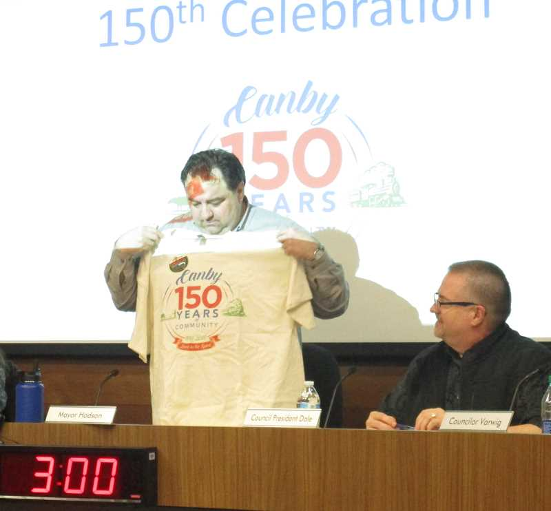 PMG PHOTO: DEBORAH GUINTHER - Mayor Brian Hodson shows off his 150 years tee.