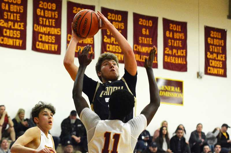 PMG PHOTO: DEREK WILEY - Canby junior Aftanom Ovchinnikoff scored 24 points Wednesday night at Central Catholic.