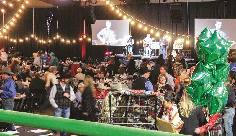 CENTRAL OREGONIAN - People enjoy their time checking out everything the Crooked River Roundup gala had to offer. The sold-out event raised about $10,000.