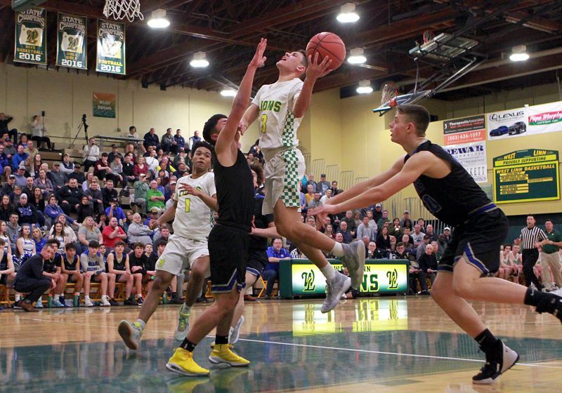PMG PHOTO: MILES VANCE - West Linn freshman Jackson Shelstad challenges the McNary defense during his team's 95-52 win in the first round of the Class 6A state playoffs at West Linn High School on Wednesday, March 4.