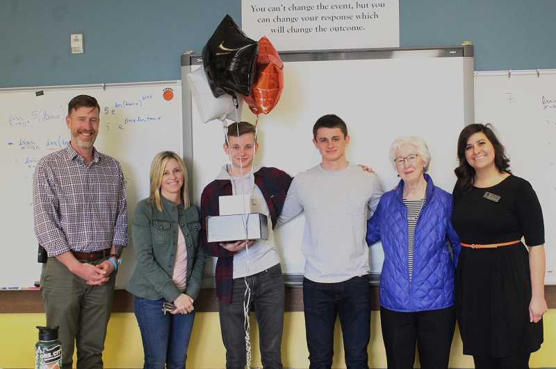 PMG PHOTO: KRISTEN WOHLERS - Drew Dawson-Hurley poses for a picture with his mom, brother, grandma, Principal Greg Dinse (left) and OSU representative Heather Wofford (right).
