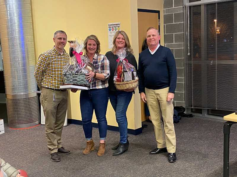 PMG PHOTO: KRISTEN WOHLERS - Pictured from left to right are Carus Principal Sam Thompson, Kara Dewar, Kristin Watts and Superintendent Trip Goodall.