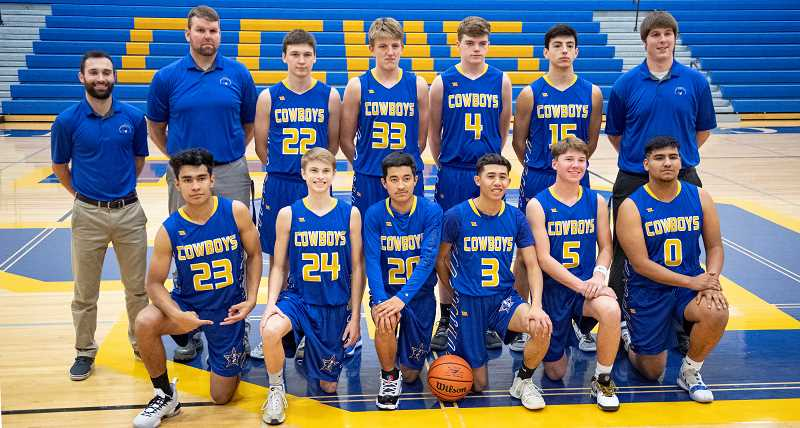 LON AUSTIN/CENTRAL OREGONIAN - The Crook County Cowboys pose for a team photo early in the year. Pictured are — Back row left to right: Assistant coach Conner Booster, assistant coach Jeff Lowenbach, Ozzie Reed, Cayden Lowenbach, Caleb Arnold, Jordan Graydon and head coach Jason Mumm. Front row: Kevin Sanchez, Brayden Ross, Jesse Sanchez, Jrei Ramirez, Hogan Smith and Abel Nunez. Not pictured: Dominik Engstrom, Cal Pickhardt and Trevyn Smith. The Cowboys finished with a 16-6 regular season record and an 8-2 league mark as they won the Intermountain Conference championship for the first time in school history.
