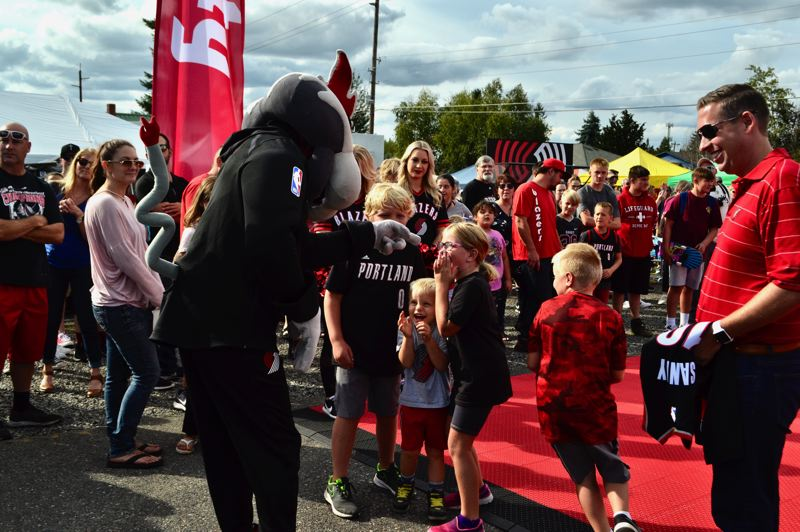PMG FILE PHOTO: BRITTANY ALLEN - In August 2019, the Trailblazers visited Sandy and hosted a RIP City Rally for the community. Now the team partnered with Moda Health are offering the city a chance at funds to further play opportunities in the community.