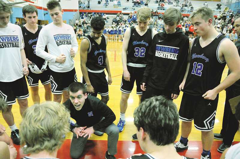GRAPHIC PHOTO: GARY ALLEN - NHS coach Mark Brown instructs the Tigers in the second half of their loss to South Salem in the first round of the Class 6A playoffs on Wednesday evening on the road.
