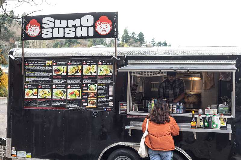 PMG FILE PHOTO - Danny Chan of Sumo Sushi prepares lunch at his PSU food cart location. The Beaverton City Library is offering a workshop to help others own their own food cart in the area.