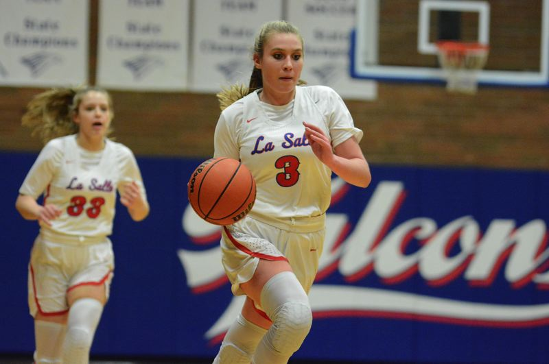 PMG PHOTO: DAVID BALL - La Salle Preps Addi Wedin moves down the floor on a fastbreak in the first half of the Falcons 97-41 playoff win over Ashland. She finished with a game-high 43 points.