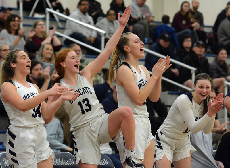 PMG PHOTO: DEREK WILEY - Angela Morris, Sydney Burns, Emilia Bishop and Keira McNamee celebrate during the fourth quarter of Wilsonvile's playoff win against Willamette.