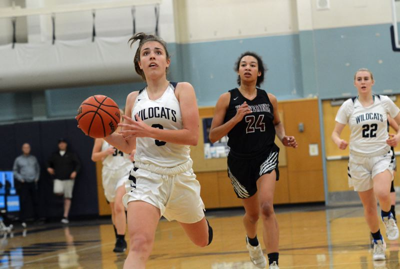 PMG PHOTO: DEREK WILEY - Wilsonville sophomore Karina Borgen scored 12 points Friday night against Willamette.