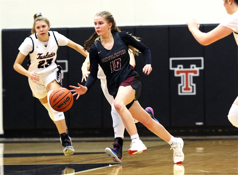 PMG PHOTO: DAN BROOD - Southridge High School senior guard McKelle Meek (10) brings the ball upcourt on a fast break during the Skyhawks' state playoff game at Tualatin. Meek scored a game-high 20 points in Southridge's 51-38 win.