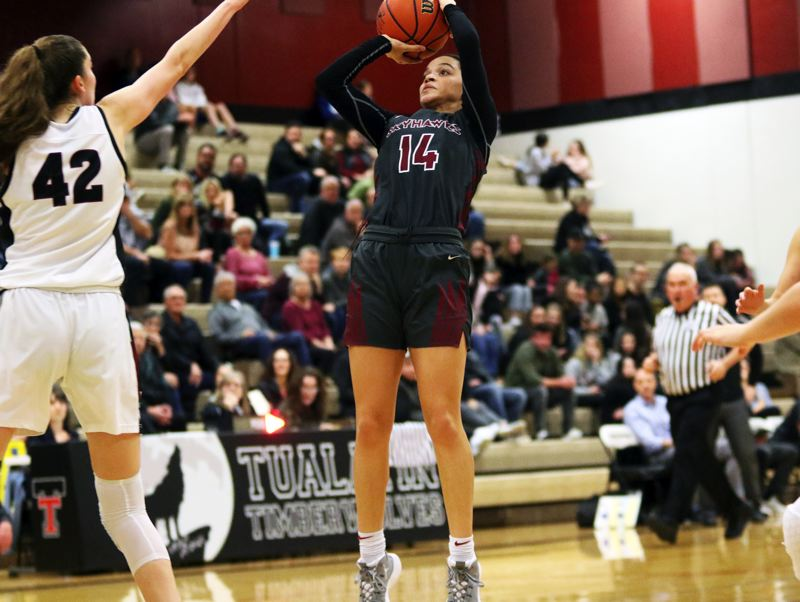 PMG PHOTO: DAN BROOD - Southridge High School senior Kyla Vinson (14) goes up for a jump shot during the Skyhawks' 51-38 win at Tualatin in Friday's Class 6A state playoff second-round contest.