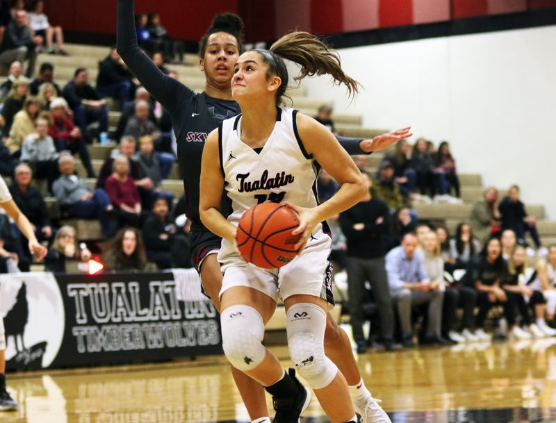 PMG PHOTO: DAN BROOD - Tualatin High School junior Sidney Dering looks to get to the basket during the Timberwolves' Class 6A state playoff second-round game with Southridge.