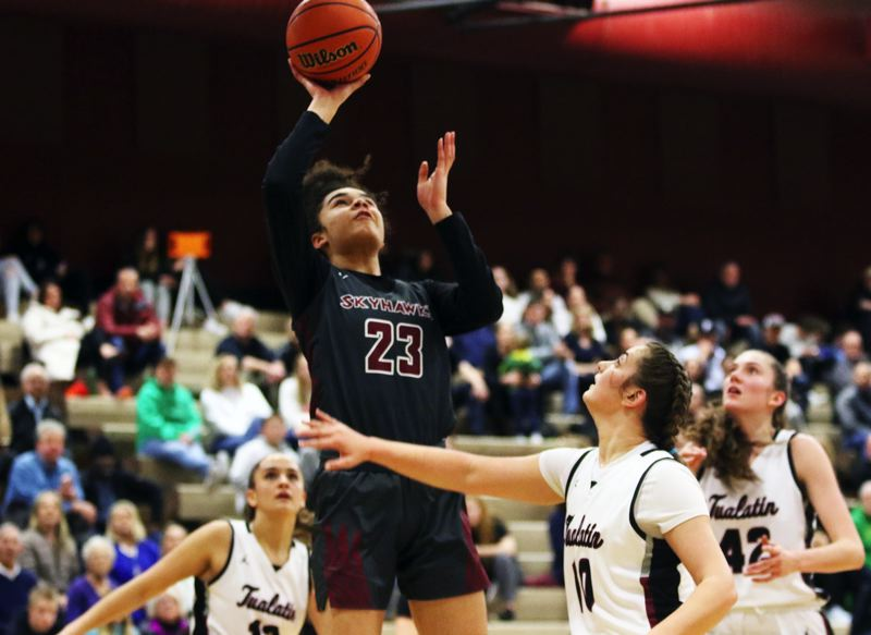 PMG PHOTO: DAN BROOD - Southridge High School sophomore Tait Quinlan (23) goes up for a shot during the Skyhawks' Class 6A state playoff game at Tualatin on Friday.