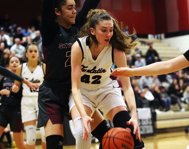 PMG PHOTO: DAN BROOD - Tualatin High School junior Natalie Lathrop looks to grab the ball while in the low post during the Wolves' Class 6A state playoff game with Southridge on Friday.