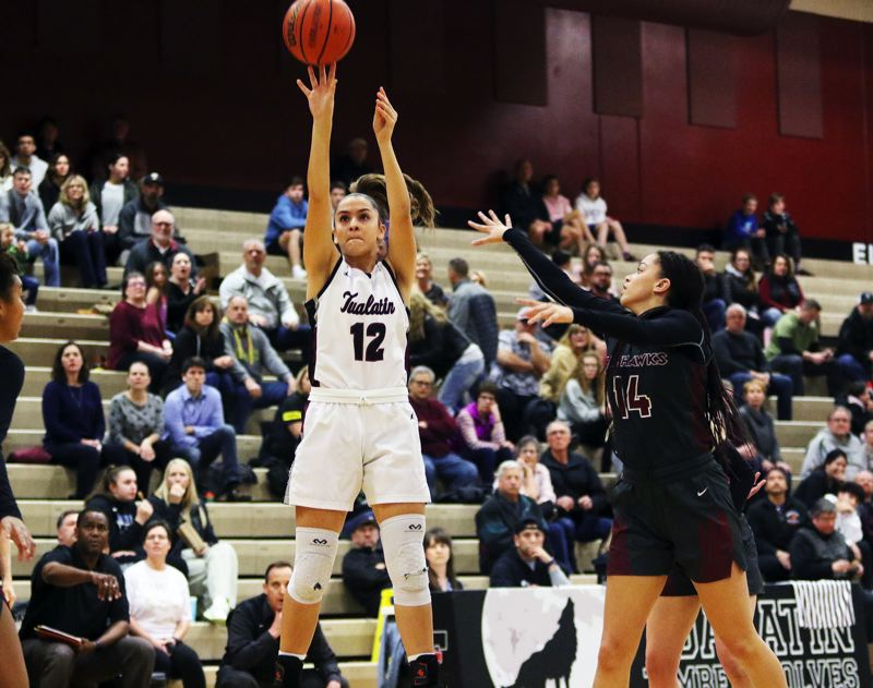 PMG PHOTO: DAN BROOD - Tualatin High School junior Sidney Dering takes a jumper during the Wolves' Class 6A state playoff game with Southridge on Friday.